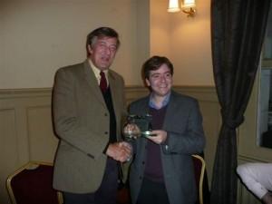Stephen Fry receiving award